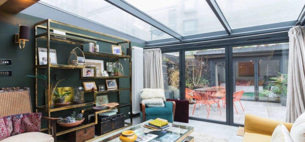 Rohelusse ja värvikirkusse uputatud eklektiline kodu