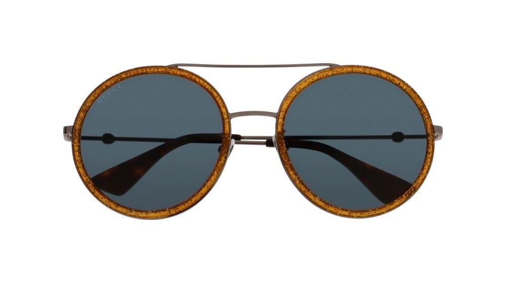 db8a297d259 Gucci ümmargused prillid on saanud põneva nüansi kontrastse tooni näol.