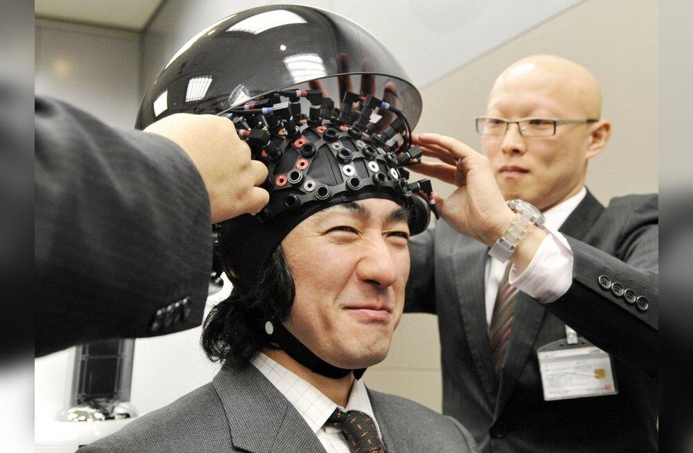 Inimene ajumonitoriga. Foto: Yoshikazu Tsuno, AFP