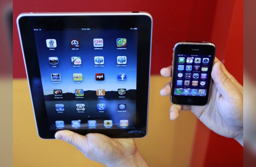 iPad ja iPhone. Foto: Paul Sakuma, AP