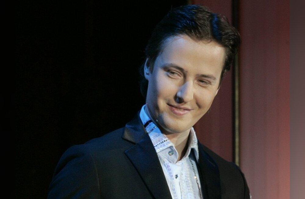 """Russian pop singer Vitas smiles holding his """"Russian of the Year"""" trophy during an award ceremony in Moscow, Friday, Feb. 29, 2008. Vitas' """"Opera #2"""" song became very popular in Asia and now he prepares a special Chinese version to be performed at the ope"""