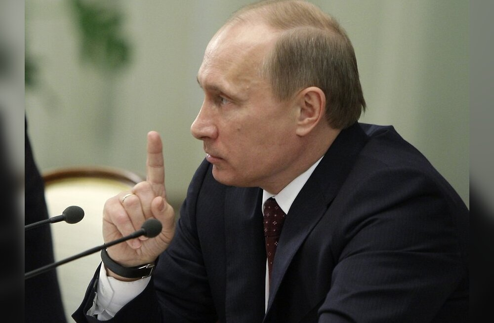 Russian Prime Minister Vladimir Putin gestures during a meeting on Russia's poor performance at the Winter Olympics in Vancouver, at the government's headquarters in Moscow, Friday, March 5, 2010. Putin took Russian sports officials to task on Friday over