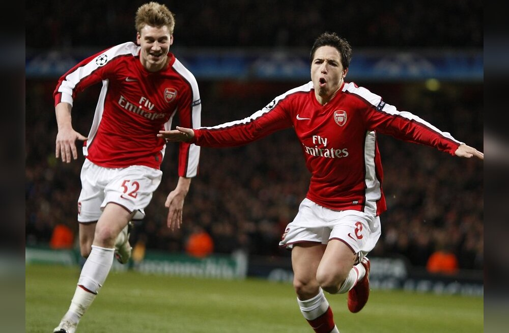 Arsenal's Samir Nasri (R) celebrates his goal against Porto with teammate Nicklas Bendtner during their Champions League last 16, second leg soccer match at Emirates stadium in London March 9, 2010.   REUTERS/Jose Manuel Ribeiro      (BRITAIN - Tags: SPOR