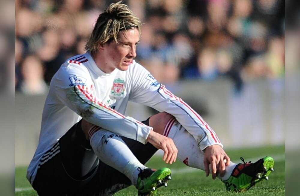Liverpool's Fernando Torres is left dejected during the game at Fratton Park