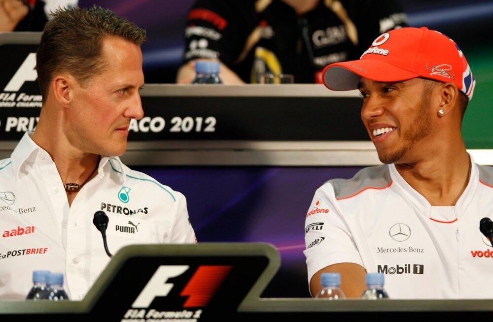 Michael Schumacher (vasakul) ja Lewis Hamilton.