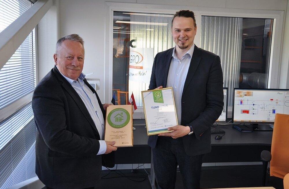 Ahto Tisler (vasakul). N.R. Energy pälvis möödunud aastal tõhusa kaugkütte märgised.