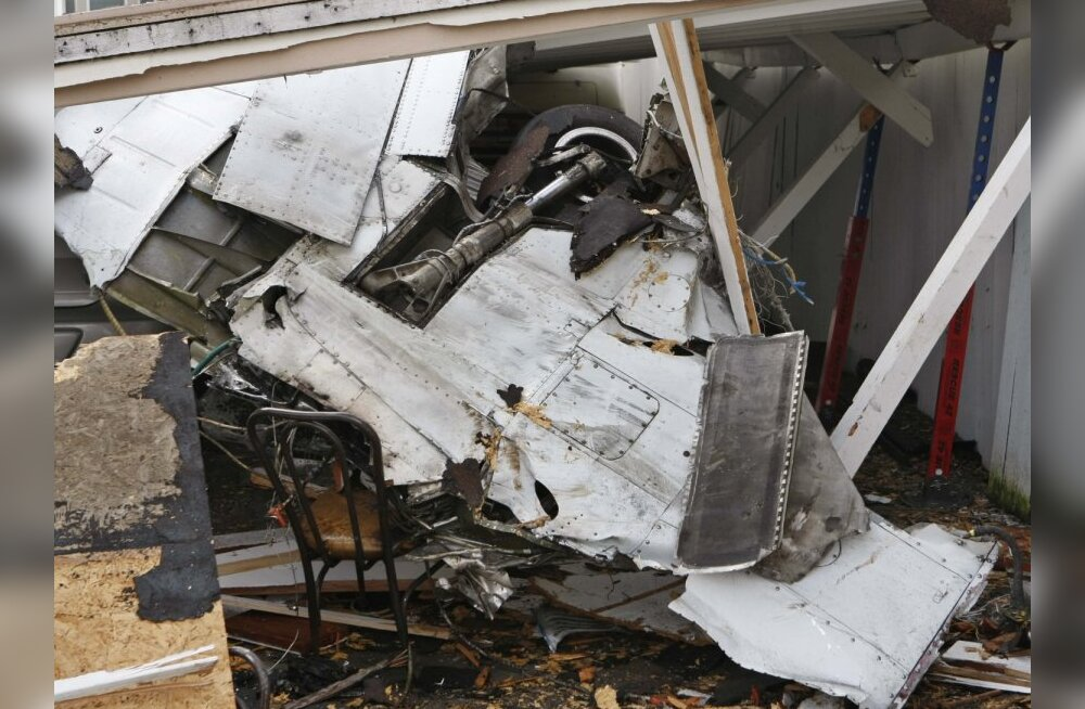 Part of a Cessna 310's landing gear is seen in the debris after it hit a house in East Palo Alto, Calif. on Wednesday, Feb. 17, 2010. The small plane crashed in the residential neighborhood shrouded in heavy fog, killing all three Tesla Motors employees a