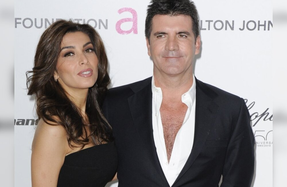 Simon Cowell (R) and Mezhgan Hussainy arrive at the 18th Annual Elton John AIDS Foundation Academy Award Viewing Party in West Hollywood, California March 7, 2010.  REUTERS/Gus Ruelas    (OSCARS-PARTY)(UNITED STATES (ENTERTAINMENT)