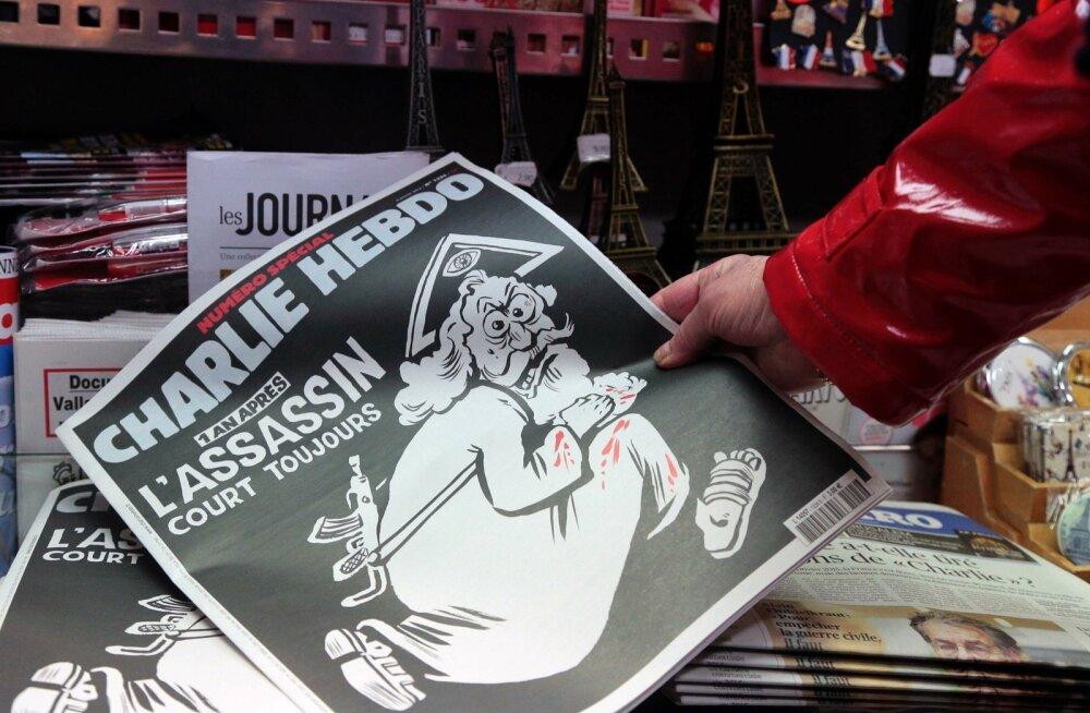 FOTOD ja VIDEO: Aasta Charlie Hebdo veresaunast: pilapilt jumalast ja trükiviga mälestustahvlil