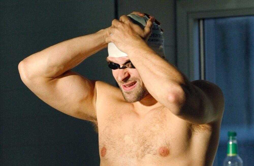 Martti Aljandi vasakut külge kaunistab olümpiamängude reklaam ehk viis rõngast.