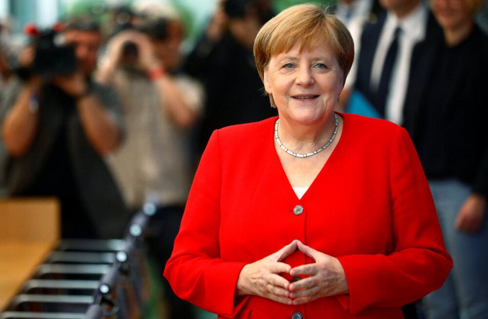 Меркель обеспокоена попытками России повлиять на европейскую политику