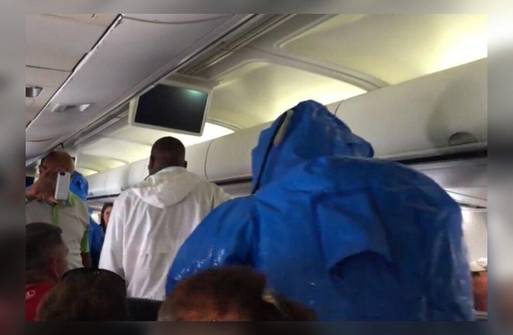 VIDEO: Lennukis ebolat maininule saabusid maandumisel vastu skafandrites mehed