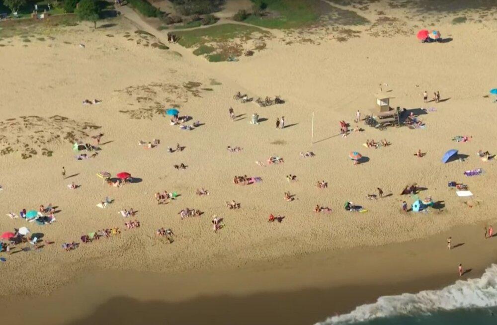 VIDEO | Kuumalaine ajab kodust välja: vaata, kuidas California rannad täituvad koroonahirmu trotsivate inimestega