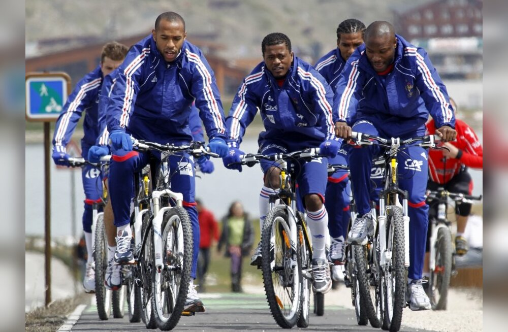 From L-R: Thierry Henry, Patrice Evra and William Gallas lead the pack of France team soccer players as they bicycle in the French Alps resort of Tignes May 19, 2010. France gathers for the first part in their World Cup soccer preparation in the French Al