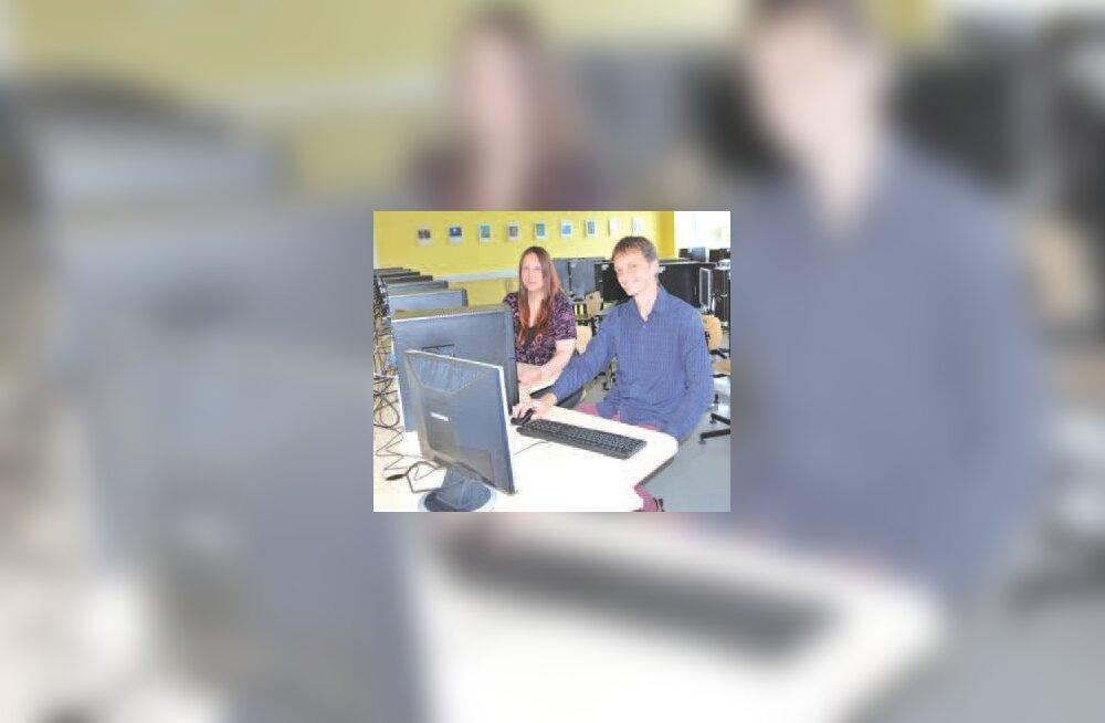 Kooli IT-spetsialist Philip James Mills ja IT-tugiisik Siret Piir uues arvutiklassis. Foto: Karin Lember