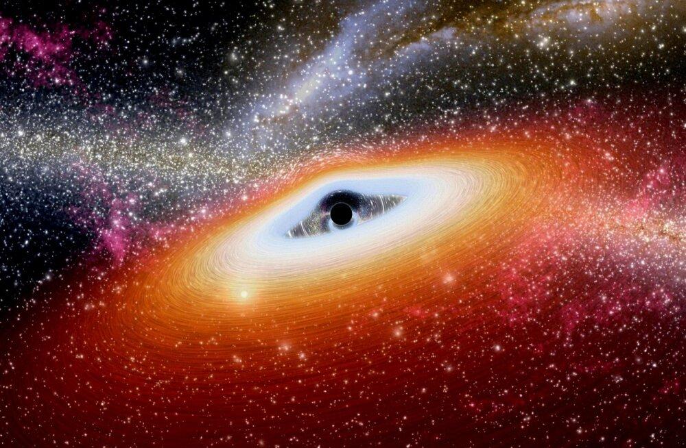 Avastatud: suur must auk, mida toidavad kuus gravitatsioonilõksu püütud galaktikat