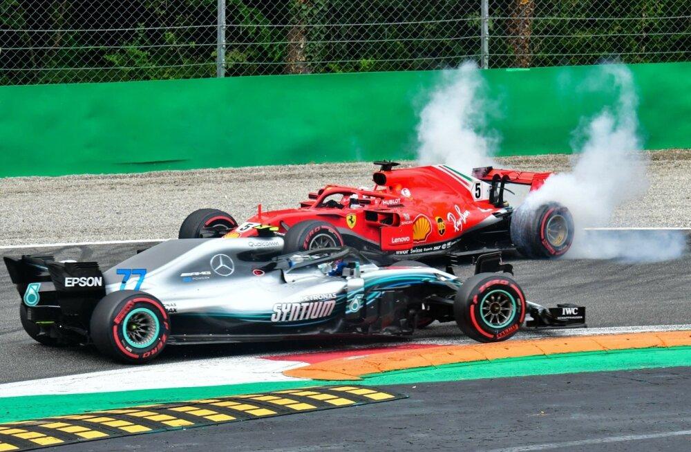 Pärast kerget kokkupõrget pööras Sebastian Vetteli Ferrari oma nina vastassuunda.