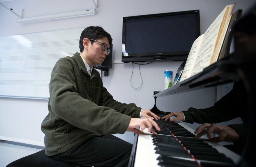 Hiina tudeng. Foto on illustratiivne.