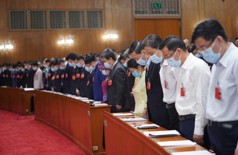 Минута молчания на конференции в Китае по жертвам коронавируса