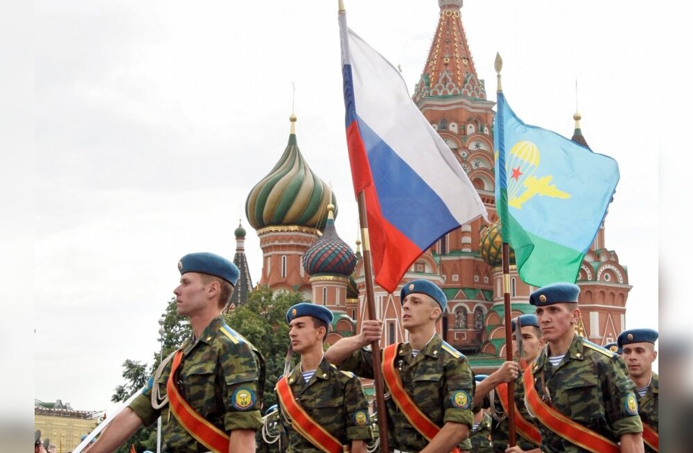 Paratroopers march with Russian National flag and the flag of the Russian Airborne Forces celebrating Paratroopers' Day at the Red Square in Moscow, Russia, Saturday, Aug. 2, 2008.  Paratroopers are an elite unit of the Russian Army, and everyone in the c