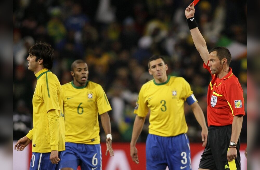 Referee Stephane Lannoy, of France, right, shows a red card to Brazil's Kaka, left, during the World Cup group G soccer match between Brazil and Ivory Coast at Soccer City in Johannesburg, South Africa, Sunday, June 20, 2010.  (AP Photo/Ivan Sekretarev) /