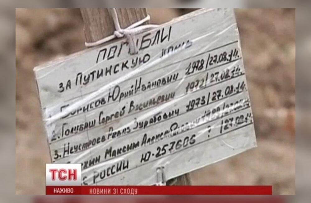 """VIDEO: Donetski lähedal avastati ühishaud tahvliga """"Hukkusid Putini vale eest"""""""