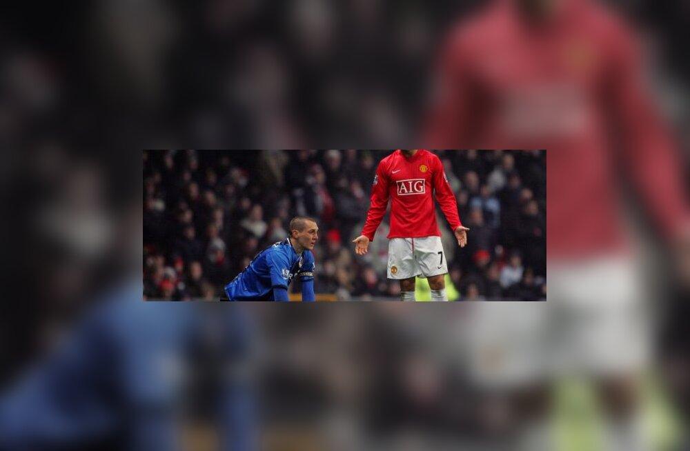 Emanuel Pogatetz ja Cristiano Ronaldo