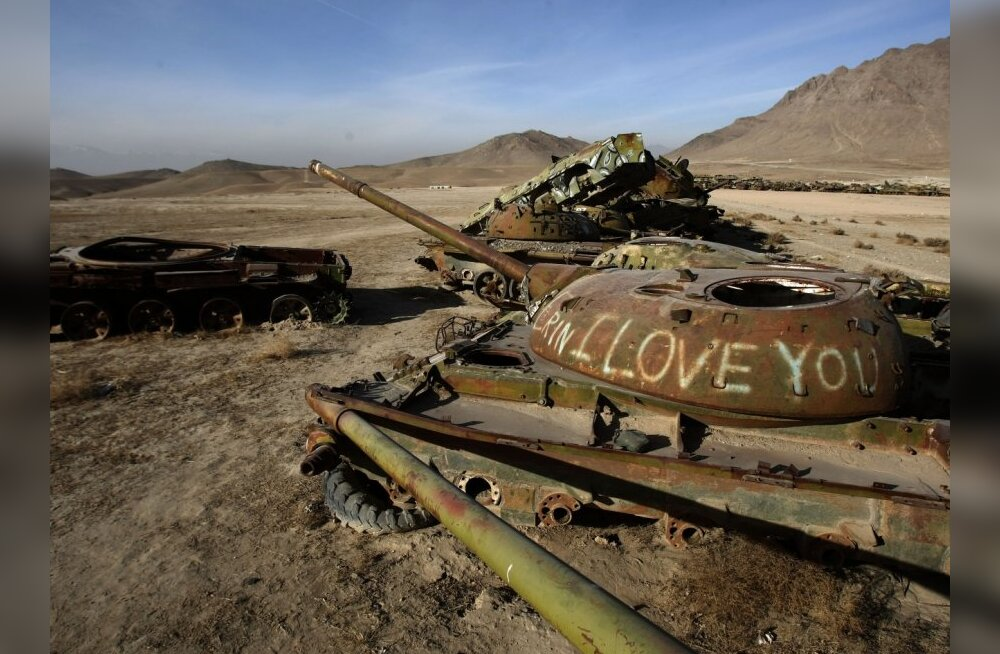 "A rusting tank carries the message ""I love you"" in a junkyard of Soviet armoured vehicles and tanks at the Kabul Military Training Camp near the capital on January 13, 2010.  The USSR began its invasion of Afghanistan in 1979 and installed more than 10,00"