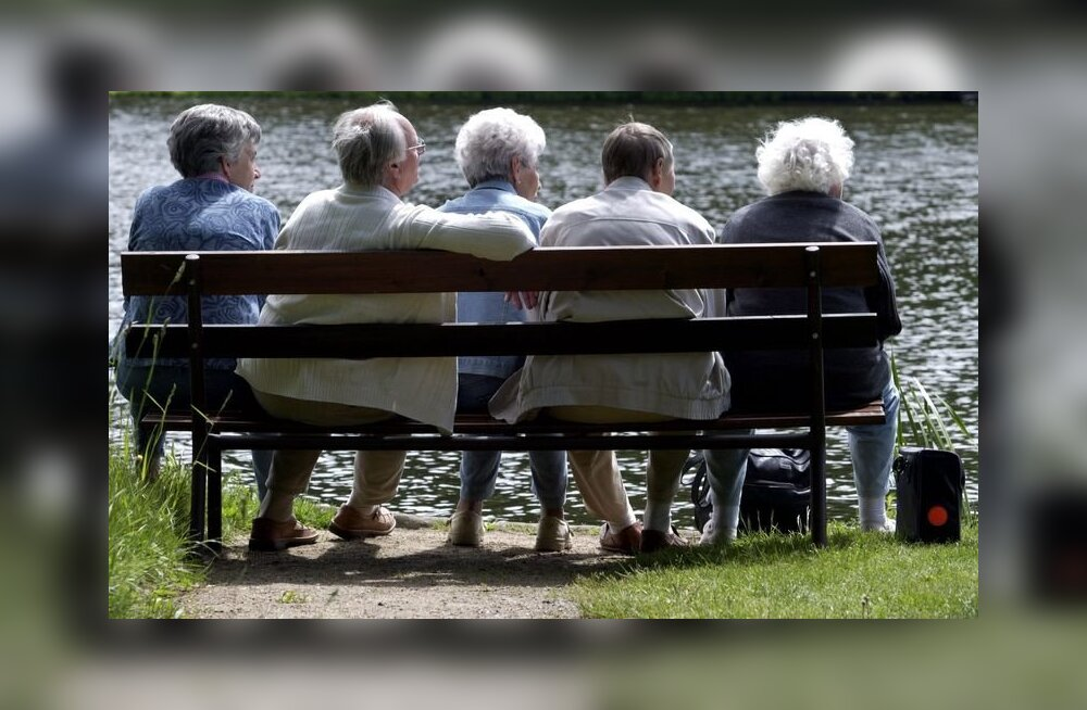 (FILES) - Picture taken on April 20, 2005 shows elderly persons sitting on a bench near a canal at the Woerlitzer Park, in the eastern German town of Woerlitz. Germany is Europe's most populous country but it also has the world's third oldest population,