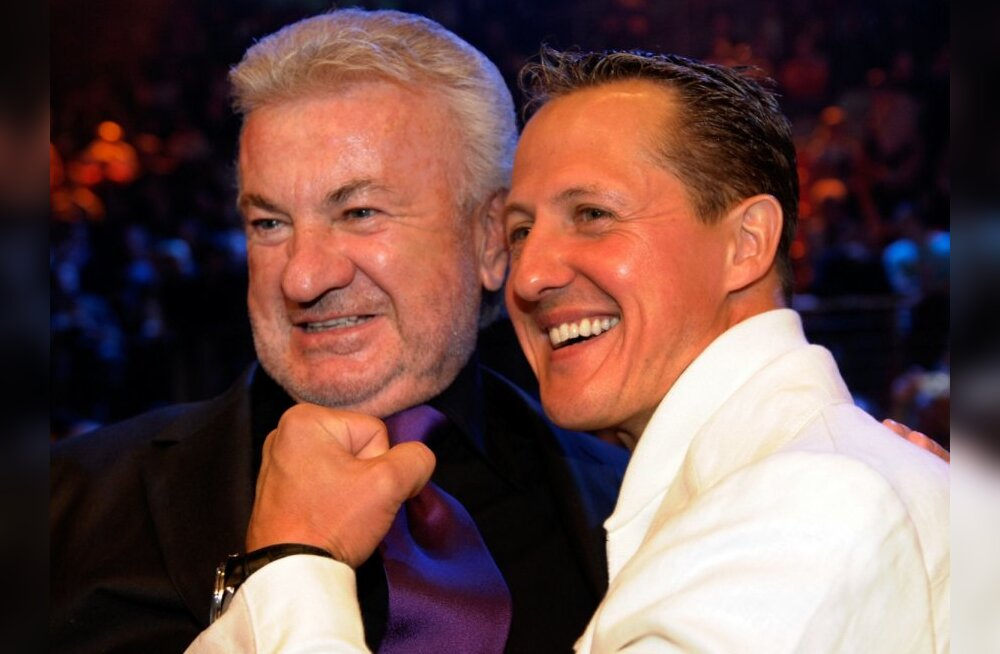 Seven time drivers champion and Ferrari team advisor Michael Schumacher (R) and his former manager Willi Weber attend the WBA middleweight world championship boxing match between German boxer Felix Sturm and Armenian-born German Khoren Gevor at the Nurbur