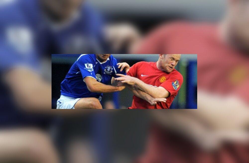 Mikel Arteta ja Wayne Rooney