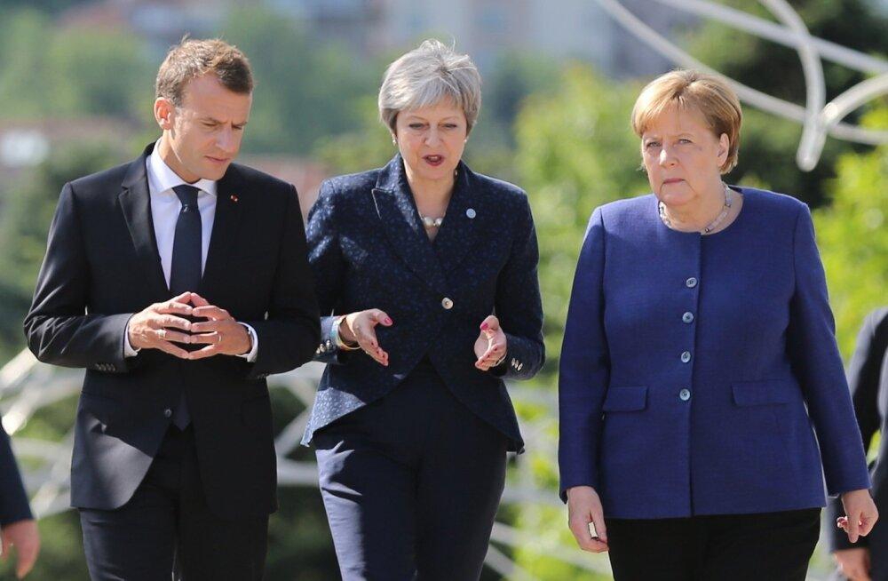 Euroopa Liidu kolm vägevat eile Sofias: Prantsuse president Emmanuel Macron (vasakult), Briti peaminister Theresa May ja Saksamaa liidukantsler Angela Merkel. Macroni käte asendit peetakse Saksamaal Merkeli tunnuseks.