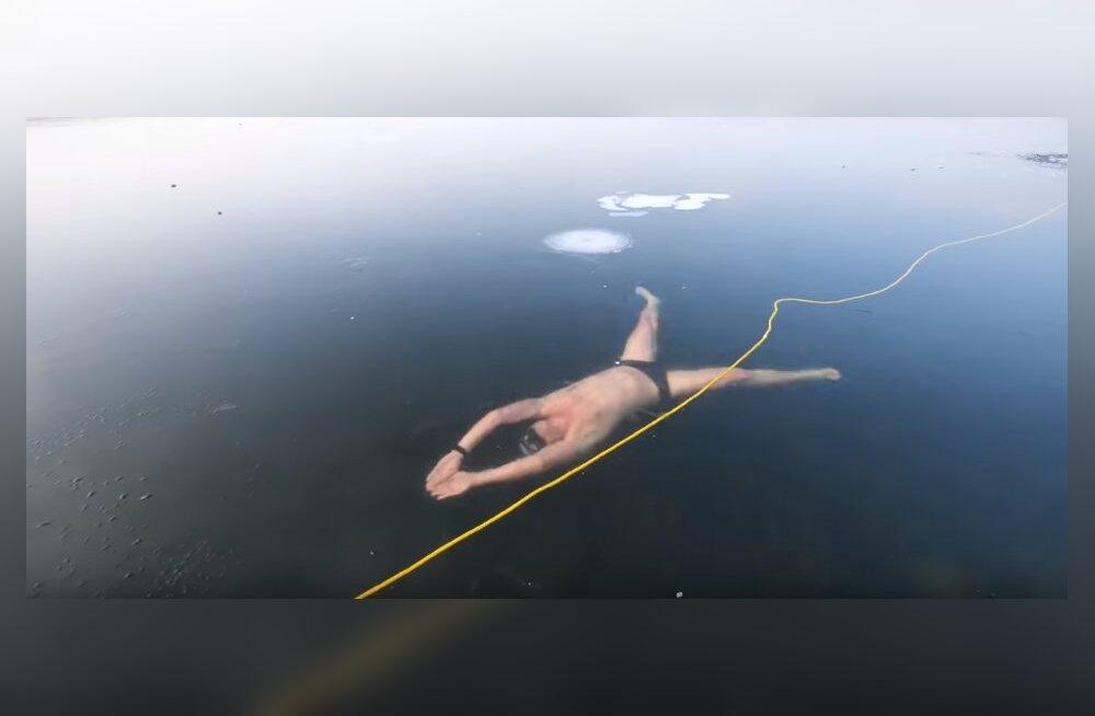 ВИДЕО. Дайвер из Чехии проплыл подо льдом озера Милада