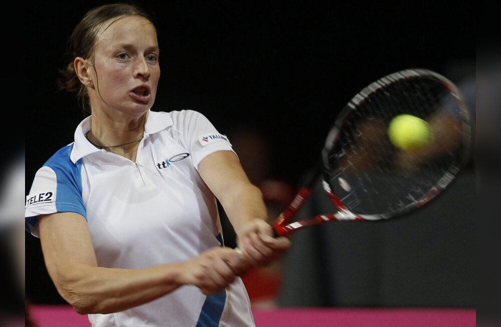 Estonia's Maret Ani returns a shot to Belgium's Kim Clijsters during their Fed Cup World Group play-off tennis match in Hasselt, April 24, 2010. REUTERS/Yves Herman (BELGIUM - Tags: SPORT TENNIS)