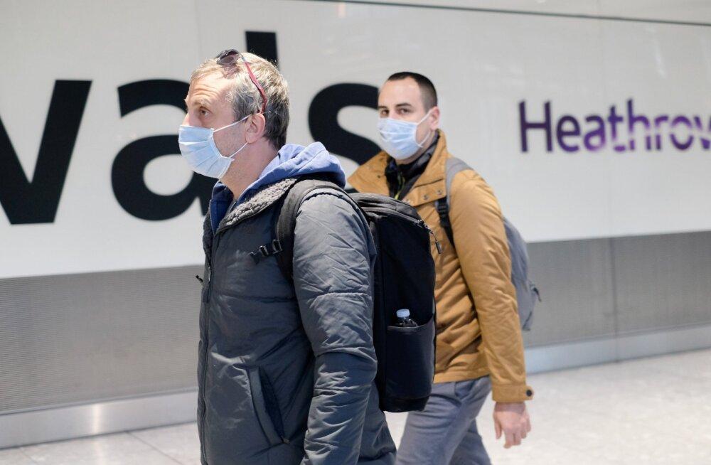 Heathrow lennujaama saabuvad turistid 29. jaanuaril. Brittide lennufirma British Airways on üks neist, kes on peatanud kõik lennud Hiina.
