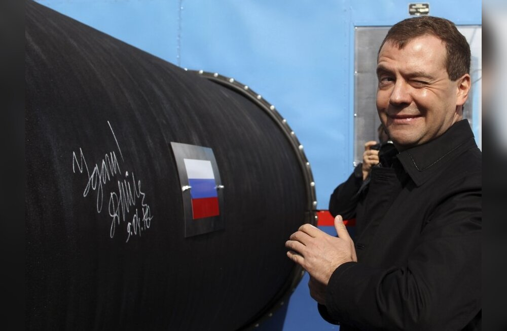 Russian President Dmitry Medvedev gestures after writing 'Good Luck!' on a pipe of the Nord Stream pipeline near Russian town of Vyborg, April 9, 2010. Medvedev took part in the ceremony on Friday to start building the pipeline, which was designed to help