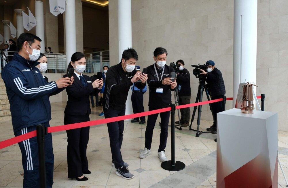 Tokyo olümpiatuli viidi peitu, kuid leek jääb põlema