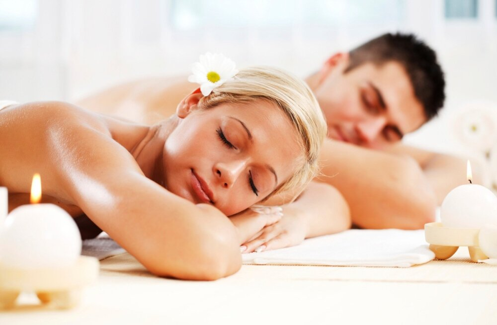 Young couple enjoying themselves at the spa centre.