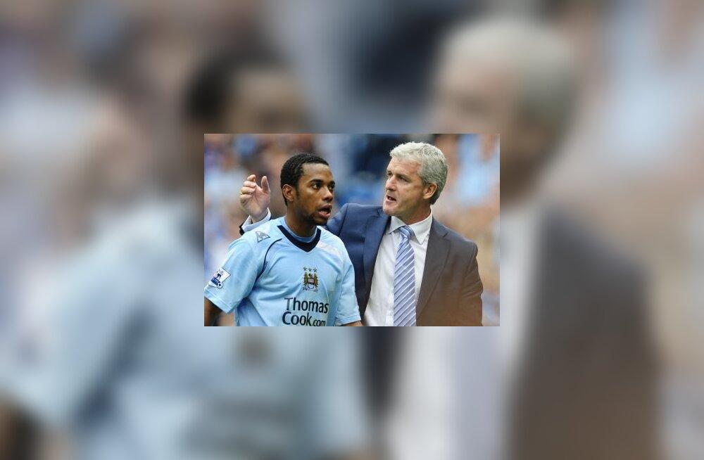 Manchester City staarmängija Robinho ja peatreener Mark Hughes
