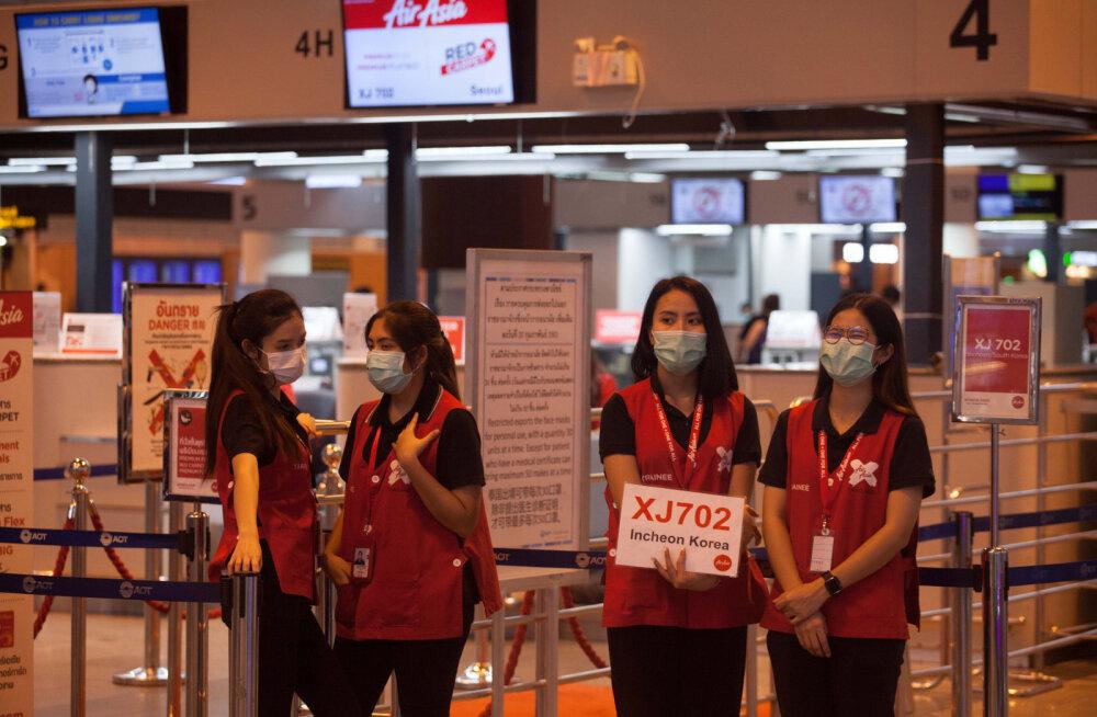 Lennujaamades kannavad töötajad näomaske.