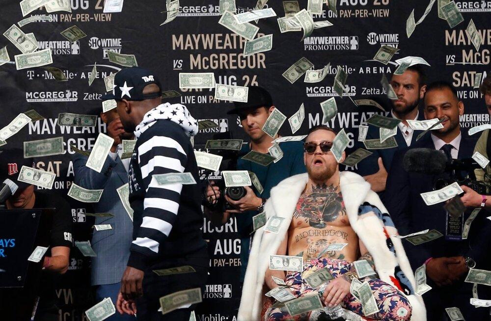 Floyd Mayweather juunior ja Conor McGregor lendlevate dollarite vahel.