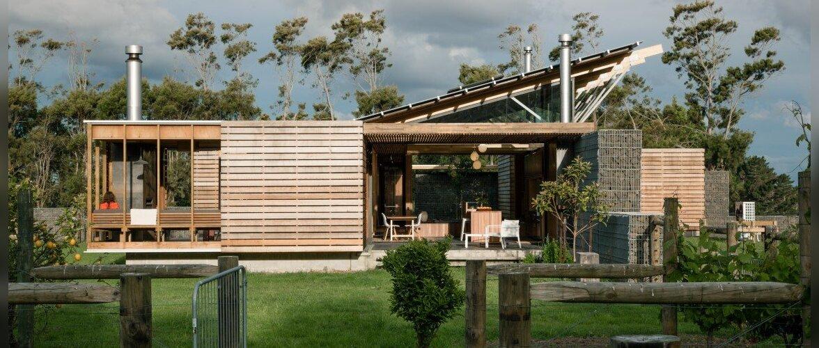 Endisele tuulekaitsealale rajatud lummava arhitektuuriga elamine