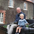 Принц Уильям и Кейт Миддлтон показали архивное фото принца Филиппа с маленьким Джорджем