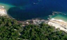 FOTOD: Austraalias neelas hiiglaslik merre tekkinud auk tüki populaarsest puhkusesaarest ja autokaravani
