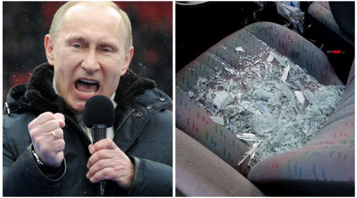 На светофоре в автомобиле разбили ломом стекло. Владелец считает, что из-за наклейки про Путина
