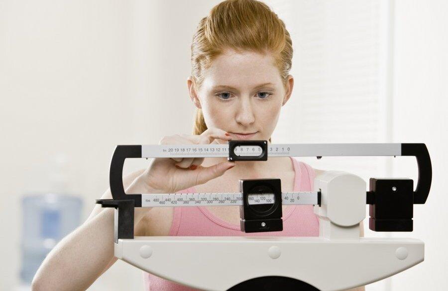 Young Woman Lifting Weights. Square Format. Фотография, картинки, изображения и сток-фотография без роялти. Image 6394197.